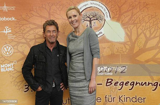 German musician Peter Maffay and former First Lady Bettina Wulff pose after speaking to the media about Maffay's charity project symposium for...