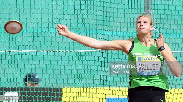 German Nadine Muller throws to win the women's discus event during the Aviva Birmingham Grand Prix at the Alaxender Stadium in Birmingham England on...