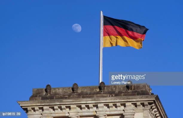 German national flag flying over Reichstag, Low Angle View, Berlin, Germany