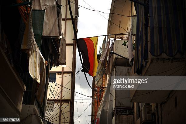 A German national flag hangs from a balcony over a street in the Armenian quarter of Bourj Hammoud of the Lebanese capital Beirut on June 6 ahead of...