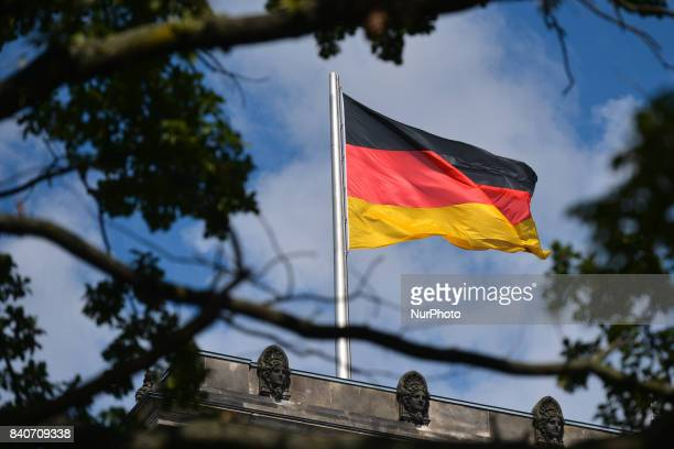 A German national flag seen at the top of the Reichstag building in Berlin On Tuesday August 29 in Berlin Germany
