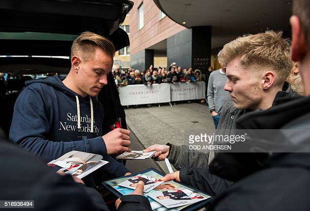 German national football team and Barcelona goalkeeper MarcAndre ter Stegen sign autographs to fans upon arrival at the team hotel in Berlin on March...