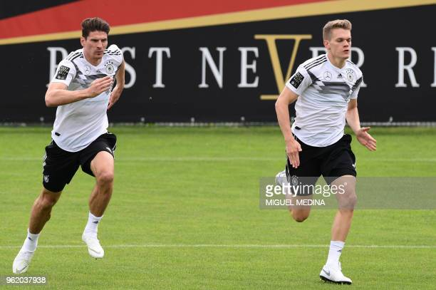 German national football team forward Mario Gomez and German national football team midfielder Matthias Ginter take part in a training session at the...