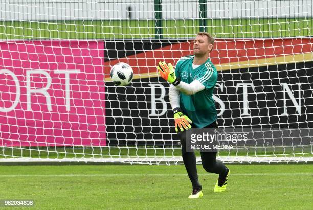 German national football team goalkeeper Manuel Neuer takes part in a training session at the Rungghof training center on May 24 2018 in Girlan near...