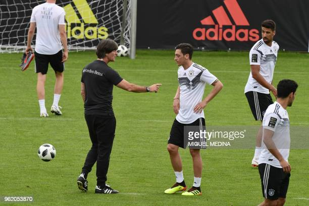 German national football team head coach Joachim Loew speaks with German national football team midfielder Mesut Ozil during a training session at...