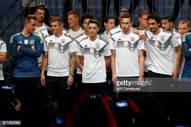 German national football team members goalkeeper Marc-Andre Ter Stegen, midfielder Toni Kroos, midfielder Mesut Ozil, midfielder Julian Draxler and...