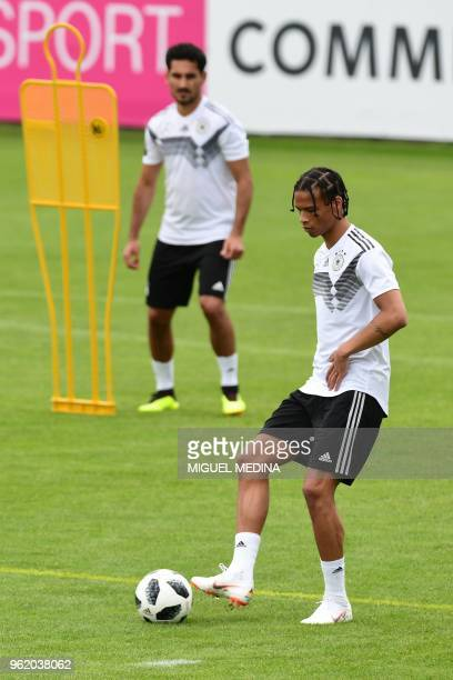 German national football team midfielder Ilkay Gundogan and German national football team forward Leroy Sane take part in a training session at the...