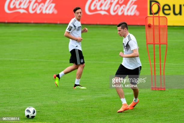 German national football team midfielders Mesut Ozil and Julian Draxler take part in a training session at the Rungghof training center on May 24...