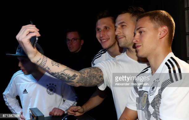 German National Football Team Player Joshua Kimmich poses with a fan as he attends the presentation of the 2018 FIFA World Cup Russia Adidas jersey...