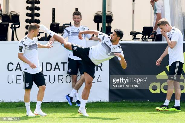 German national football team players forward Joshua Kimmich forward Thomas Müller and midfielder Sami Khedira take part in a training session at the...
