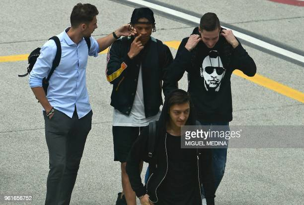German national football team players Leroy Sane and Mesut Ozil arrive at the Bolzano airport north eastern Italy on May 23 where the team will stay...