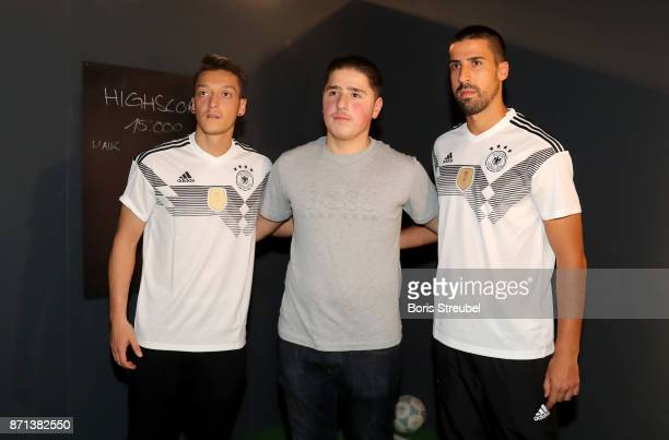 German National Football Team Players Mesut Oezil and Sami Khedira attend the presentation of the 2018 FIFA World Cup Russia Adidas jersey at The...