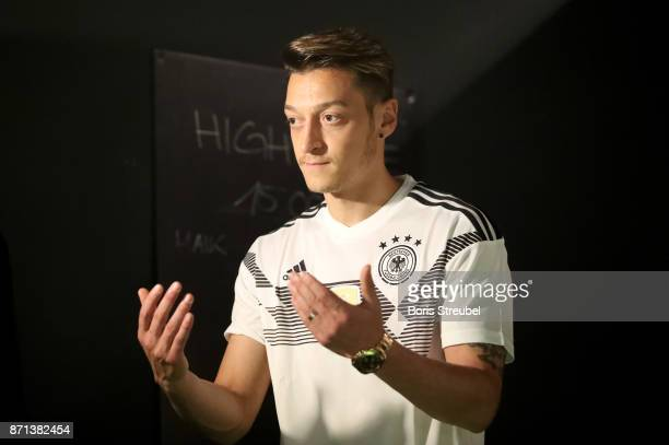 German National Football Team Players Mesut Oezil attends the presentation of the 2018 FIFA World Cup Russia Adidas jersey at The Base on November 7...