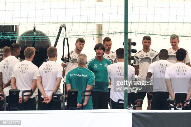 German national football team's head coach Joachim Loew speaks to his players during a training session at the Rungghof training centre on May 26...