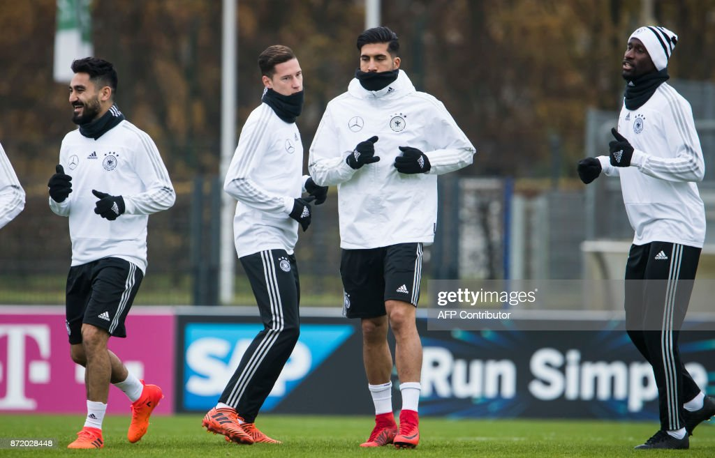 German national football team's midfielder Ilkay Guendogan, midfielder Julian Draxler, defender Emre Can and defender Antonio Ruediger take part in a training session on November 9, 2017 at the training grounds of the Olympic stadium in Berlin, ahead of two friendly matches away to England. / AFP PHOTO / Odd ANDERSEN