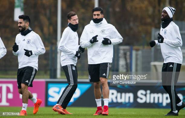 German national football team's midfielder Ilkay Guendogan midfielder Julian Draxler defender Emre Can and defender Antonio Ruediger take part in a...