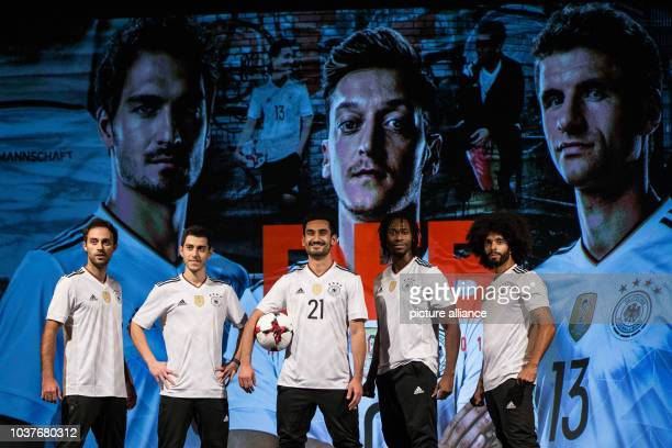 German national soccer player Ilkay Guendogan and dancers posing during the presentation of the new home jersey of the German national soccer team by...