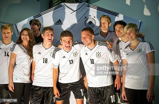 German national soccer team coach Joachim Loew pose with players Holger Badstuber Toni Kroos Thomas Mueller Lukas Podolski Per Mertesacker and Mats...