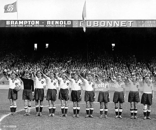 German national soccer team players execute the nazi salute 04 June 1938 at the Parc des Princes stadium in Paris before the start of their World Cup...