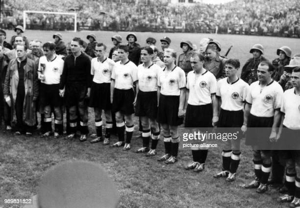German national soccer team players stand in file as they are honoured as the World Champions after Germany beat Hungary in the 1954 World Cup final...