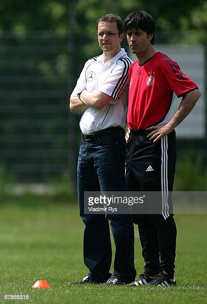 German National Team doctor Tim Meyer and assistant coach Joachim Loew look on during the fitness training of the German National Team on May 8 2006...