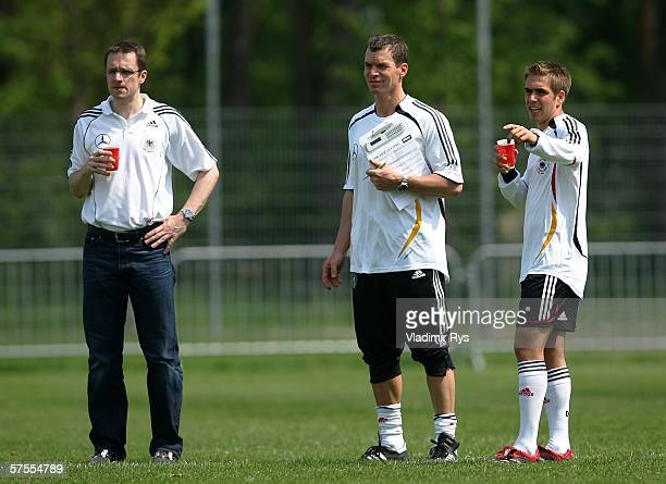 German National Team doctor Tim Meyer fitness coach Oliver Schmidtlein and Philipp Lahm of Bayern Munich look on during fitness training of the...
