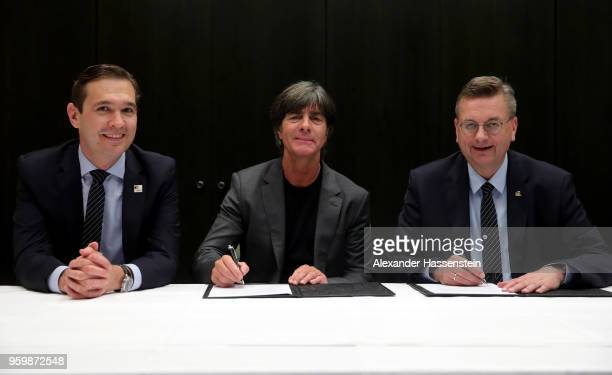 German national team head coach Joachim Loew and DFB president Reinhard Grindel sign a contract extension whilst DFB general secretary Dr. Friedrich...