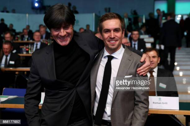 German national team head coach Joachim Loew and former German national player Philipp Lahm look on prior to the Extraordinary DFB Bundestag at Messe...
