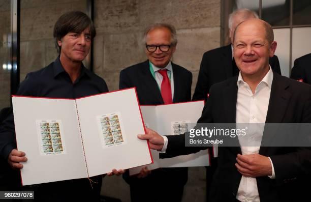 German national team head coach Joachim Loew Deutsche Sporthilfe CEO Werner E Klatten and federal finance minister Olaf Scholz present a new set of...