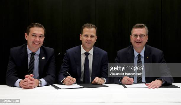 German national team manager Oliver Bierhoff and DFB president Reinhard Grindel sign a contract extension whilst DFB general secretary Dr. Friedrich...