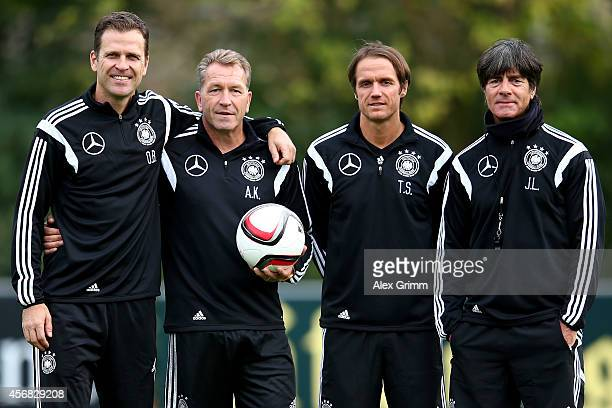 German national team manager Oliver Bierhoff goalkeeping coach Andreas Koepke assistant coach Thomas Schneider and head coach Joachim Loew pose...