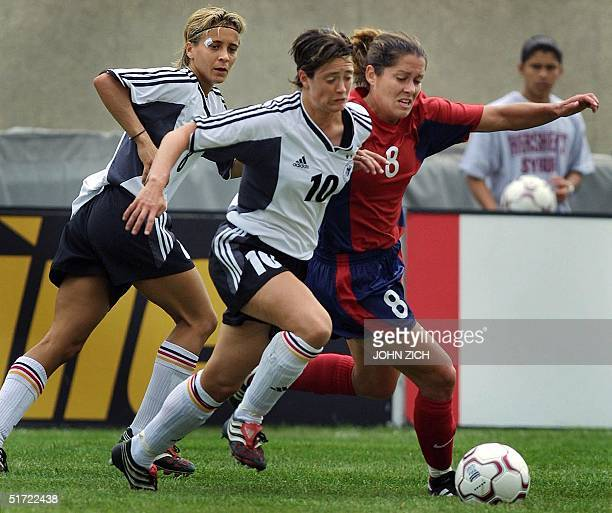 German national team members Renate Lingor and Sandra Smisek fight for the ball with US midfielder Shannon MacMillan during the 2001 Nike Women's Cup...
