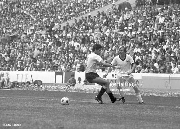 German national team player Sigi Held in a duel with a player from Uruguay in the game for third place at the 1970 Football World Cup at Aztec...