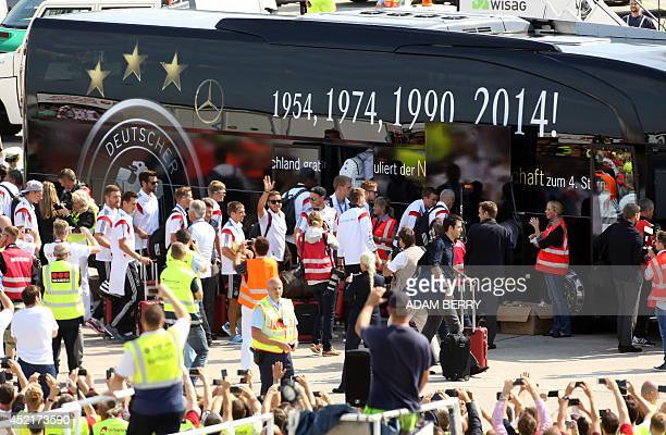 German national team players are greeted by fans as they board a bus at Berlin airport Tegel on July 15 as they arrive from Brazil after they won the...