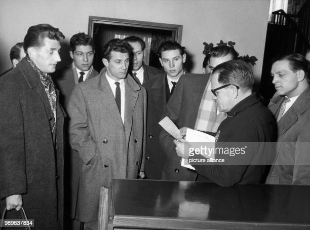 German national team players arrive at a hotel in Frankfurt/Main on 17 March 1958 where coach Sepp Herberger announces the room numbers to each...