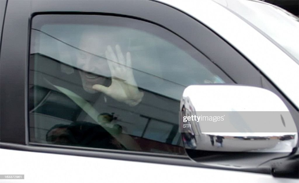 German national Uwe Breuer waves upon arrival at Catam airport in Bogota, upon his release by the National Liberation Army guerrillas, on March 8, 2013