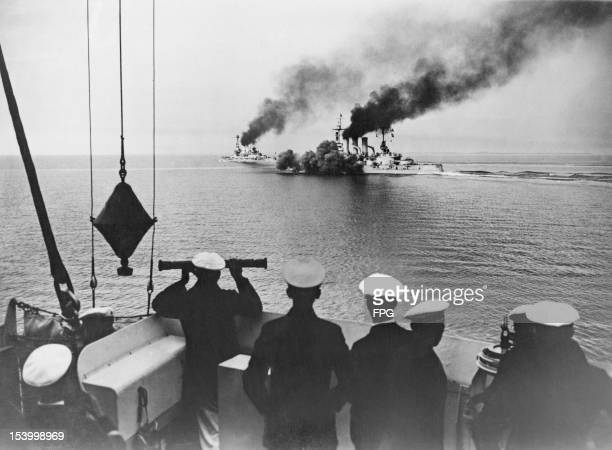 German naval personnel watching the battleship SMS Hessen during annual manoeuvres off Kiel September 1930