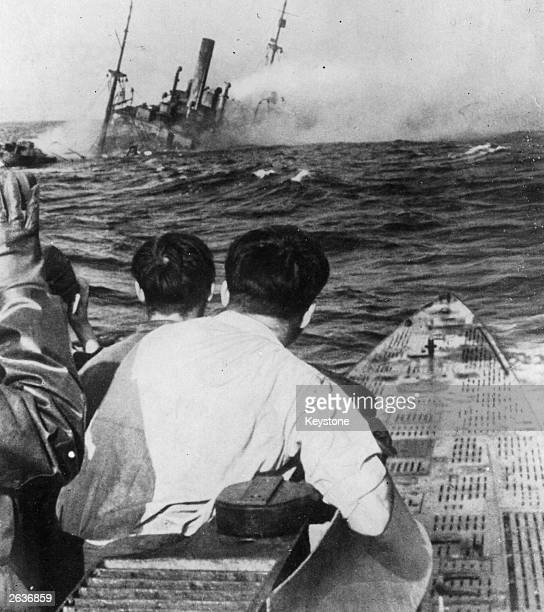 German navy crew proudly watch as one of their victims an American merchant ship sinks