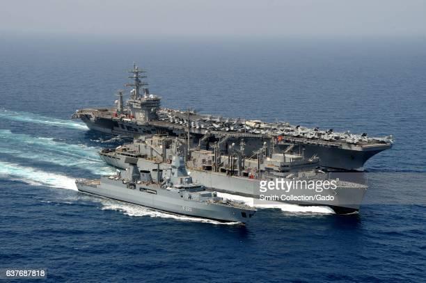German navy frigate FGS Hamburg aircraft carrier USS Dwight D Eisenhower and Military Sealift Command fast combat support ship USNS Bridge...
