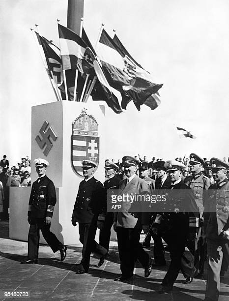 German nazi Chancellor Adolf Hitler is seen with Admiral Miklos Horthy Regent of Hungary during the launching ceremonies of the 'Prinz Eugen' cruiser...