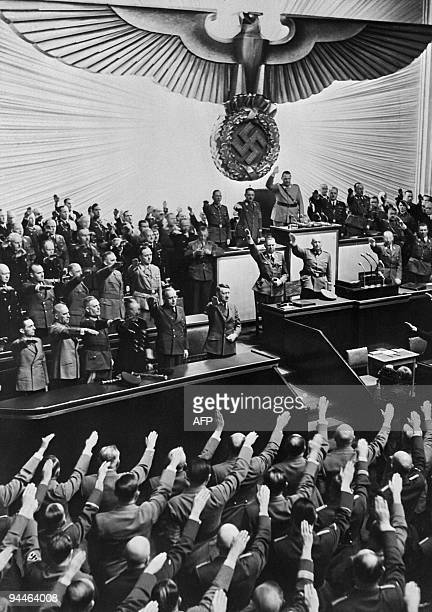 German Nazi chancellor Adolf Hitler receives an ovation from the Reichstag and members of parliament who give him the nazi salute for the �Anschluss�...