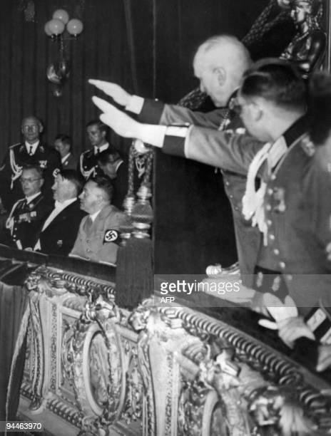 German Nazi Chancellor Adolf Hitler sits between his close collaborator Martin Bormann and future Governor of Austria Arthur Seyss Inquart in March...