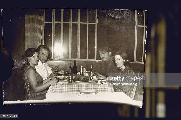 German Nazi doctor and war criminal Josef Mengele eats with an unidentified woman and man and maid Elza Gulpian de Oliveira, Brazil, 1970s.