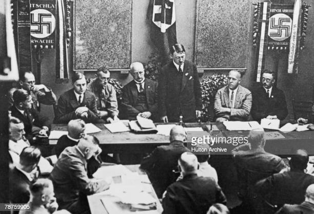 German Nazi leader Adolf Hitler at a party meeting in Munich circa 1925 Also present are Alfred Rosenberg Gregor Strasser and Heinrich Himmler