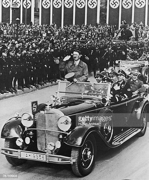 German Nazi leader Adolf Hitler on his way to deliver an oration at a party rally in Nuremberg circa 1935 Seated behind him is Propaganda Minister...