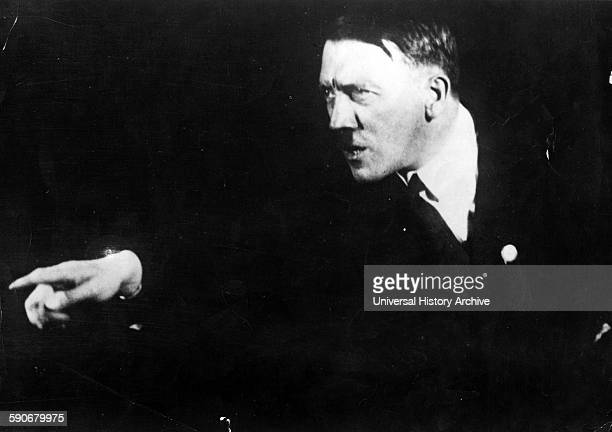 German Nazi leader Adolf Hitler rehearsing a speech in front of the mirror 1933