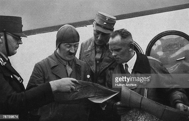 German Nazi leader Adolf Hitler studies a flight map with his personal pilot Hans Baur during an election campaign circa 1930 Picture 91 of a series...
