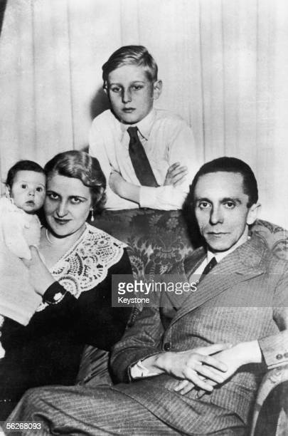 German Nazi politician and minister of propaganda Paul Joseph Goebbels with his wife Magda their first child Helga Susanne and Magda Goebbels' son by...