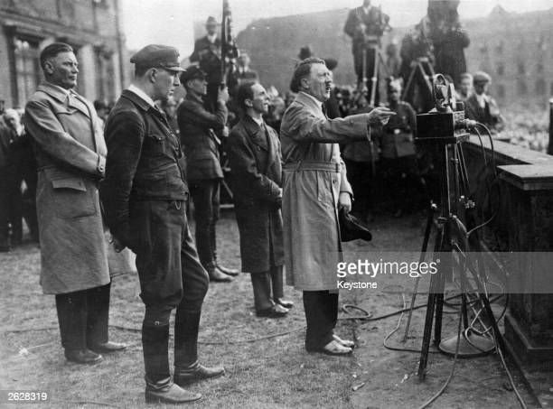 German Nazi politician Joseph Goebbels listens to Adolf Hitler making his election speech.
