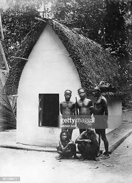 German New Guinea Bismarck Archipelago Natives in front of their hut on Matty Island probably in the 1910's